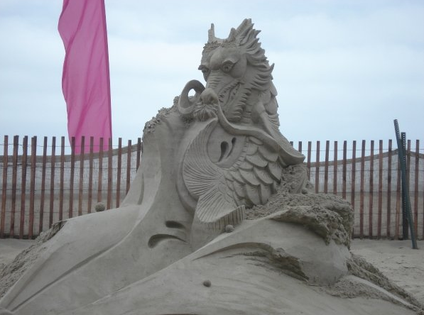 picture of dragon built with sand.